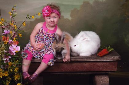 Shalynn Oller, daughter of Nathan Oller and Brittany Colvin, Bardstown, poses with some Easter bunnies.