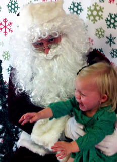 Santa's face says it all when Harper Ward visits with him.