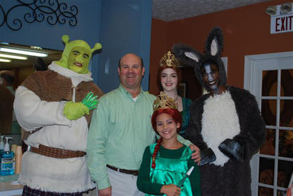 """The """"Shrek"""" cast visited Mattingly and Howell Orthodontics, 208 N. Second St. in Bardstown  July 30. They spent about an hour visiting with patients and staff. Little Fiona is Dr. Chris Howells' daughter, Eva Kate Howell."""