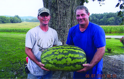 Bobby Joe and Jason Newton grew this watermelon weighing 78 pounds on Harvey Hayden's farm in Boston.