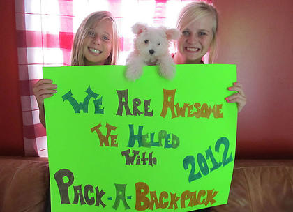 Hannah and Madison Hawkins helped with Pack A Backpack 2012. They helped collect more than $2,000 worth of school supplies for local schools. 