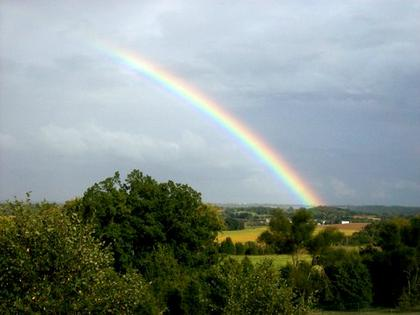 "Joseph Dittman, Bardstown, took this photo after a summer storm in 2010. This rainbow appeared east of the Valley View subdivision. The photographer labeled the photo ""Rainbow Over Paradise."""