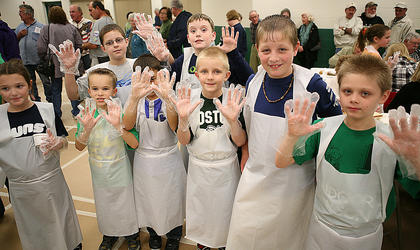 Boston School student servers line up to show off their gloved hands during the 95th annual Boston Oyster Supper, Saturday, in Boston. At least 40 students, mainly fourth and fifth graders helped out with serving duties during the event, which attracted about 1,000 people this year. They consumed 2,200 rolled oysters. Pictured are: (Front Row, from left) Natalie Skinner, Gavin McGovern, Dylan Parrish, Justin Malone, DJ Muncy and Matthew Murphy; (Back Row) Bryan Blicharz and Isaac Cothern.