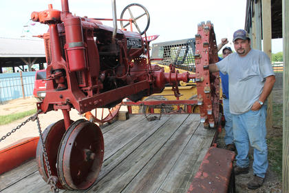 "David Barnes stands beside father-in-law Walter ""Buck"" Durbin's 1938 Farmall tractor."