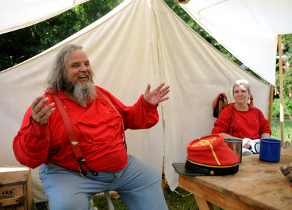 Larry Bruner, Oldham County, tells stories to campers at the Old Bardstown Village Saturday. Bruner and his wife, Patsy attended the civil-war reenactment Saturday and Sunday.
