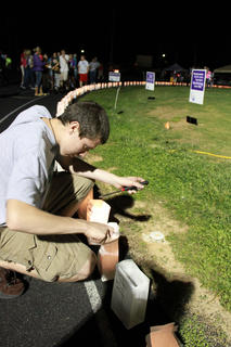 Drew Pomerleau and other members of the 4-H Teen Council were responsible for lighting the luminaria at Relay for Life May 13-14 and keeping them lit into the night.