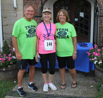 Sandy Wolf of St. Gregory Catholic Church was the winner of the 70-and-over category in the Run for the Health of It 5K Saturday in Bardstown. She is shown with Leon and Margaret Claywell of Medica, the presenting sponsor.