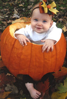 Amelia Filiatreau, six months, smiles as she sits inside a pumpkin at her home in Bardstown. Amelia is the daughter of Blake and Jennifer Filiatreau.