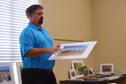 "Randy Burba speaks about photography at the Bloomfield Branch Library Saturday as part of ""Appetizers with the Artist."""