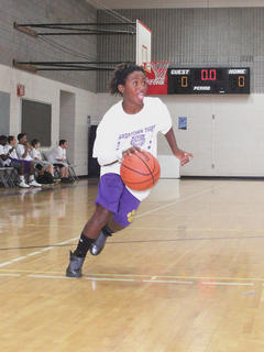 Terrence Banton, 11, dribbles around the court during the Bardstown Tigers' Basketball Camp.