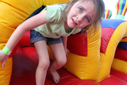 Clair Hodges, 5, Cardinal Hill, plays in the Kids' Fun Zone at the Bourbon City BBQ Festival Sept. 3. Hodges' father, Chris Hodges, competed with the Bullspit BBQ team in the festival's cook-off, which had 14 competitors.