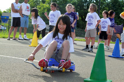 A Bardstown Primary School weaves through cones in a relay race at Bardstown Primary School's Tigerpawlooza field day June 2, 2011.