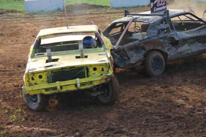 Boom! No. Bradley Lancaster of Vine Grove, in the black car, scores a solid hit against Jeremy Hicks of Loretto in the Demolition Derby.