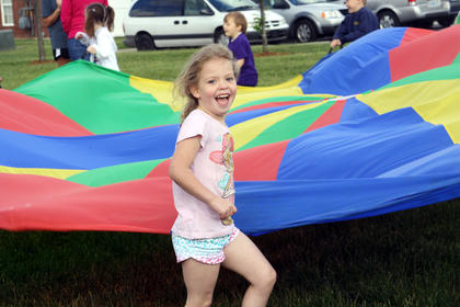 Breonna Hillard, a kindergartener at Bardstown Primary, laughs in excitment as she and her classmates participate in a field day activity during Tigerpawlooza Friday, May 24.
