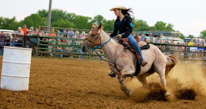 Tory Tate, of Cox&#039;s Creek, guides her mount toward a barrel during the barrel-racing competition Tuesday at the Nelson County Fair.