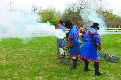 Re-enactors fire a cannon on the grounds of Wickland, a historic mansion.