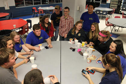 Students, including FFA members, have fun eating chili and chatting with friends at the FFA Alumni chili supper at Nelson County High School Friday night.