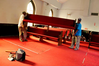 About 50 volunteers helped remove the pews and other items from the 199-year-old First Baptist Church Aug. 13 in preparation for its conversion into the Reverend Roy Henry Educational Center.