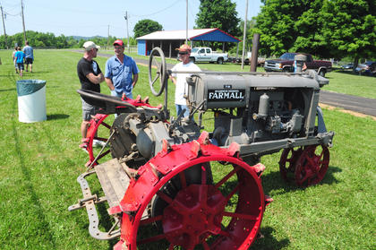 Kenny Blair, Bullitt County brought his 1932 tractor to the show, notable for its steel wheels. Mike Taylor, Shepardsville and Duwayne Nation, Mt. Washington, hang out with Blair.