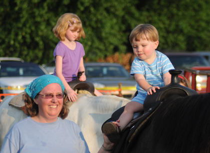 Charlie Holderman, 17 months, Springfield, rides a horse at the Salt River Electric Company Picnic.