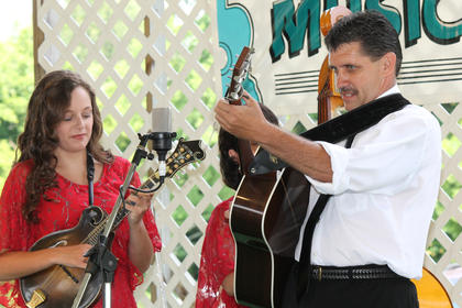 Samantha Patrick plays the mandolin and her dad, Rob Patrick, the guitar, in The Daniel Patrick Band of Bethel, Ohio. The group didn't include Daniel, who left two weeks ago to join The Roys in Nashville.