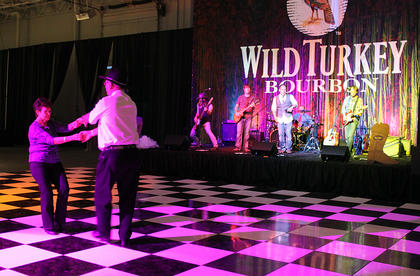 Pat and Donnie Allender of the New Haven area dance to the music of a live country-western band at Boots & Bourbon Thursday night, where guests got their bourbon from the Wild Turkey Sit 'n' Sip Saloon, played cornhole, posed for photos and rode the mechanical bull. Guests enjoyed dinner and dancing at the Guthrie Opportunity Center at 900 Nutter Drive, which also hosted the Great Kentucky Bourbon Tasting & Gala Saturday night.