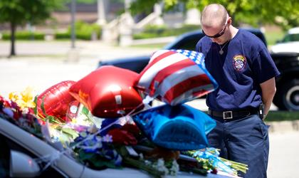 A visitor to the Bardstown Police station Monday pays his respects to fallen Bardstown Police Officer Jason Ellis.