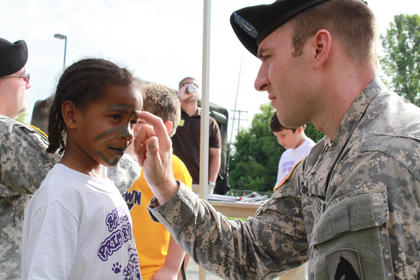 The military made a special visit to paint students' faces in camouflage colors at Bardstown Primary School's Tigerpawlooza field day June 2, 2011.