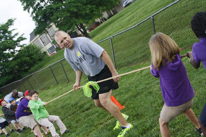 SFC Michael Tilson, with the Army Reserve Readiness Center, tells a class of third graders to start pulling during a tug-of-war at Bardstown Primary Friday, May 24.