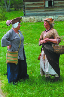 Frontier women. The one on the right is a white slave, an Irish indentured servant, portrayed by Carol Jarboe.