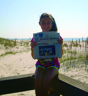 "Kaelyn Walker, 10, took The Kentucky Standard with her on vacation to Gulf Shores in October. When she opened the paper, she found her team's winning photo ""Lightning Boltz"" soccer team won the Elizabethtown tournament Oct. 7 during fall break."