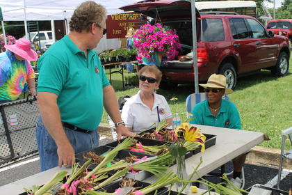 Members of the Daylily Society of Louisville enjoy a chat at the Extension Service offices during the Blooming Bardstown Garden Tour and Marketplace. From left are Joseph Powell, Helen Porter and Rosie Powell, all of Louisville.