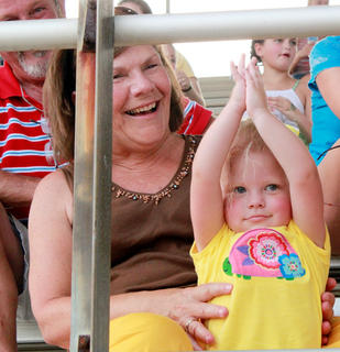 """Aubrey Robbins, 2, daughter of Jason and Lee Anne Robbins, dances to the """"Y-M-C-A"""" at the Miss Pre-Teen Nelson County pageant while her grandmother, Ann Robbins, watches."""