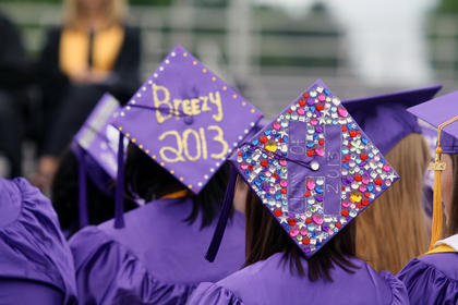 Several students decorated the back of their graduation caps.