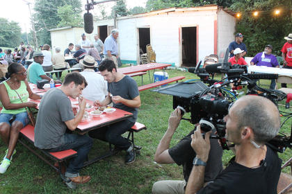 A film crew from TLC  videos Tom and Henry Herbert having some wild game at Buttermilk Days.