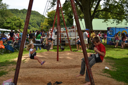 Children spend time on a swing set at the Howardstown Homecoming on Sunday afternoon.