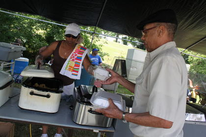 Sherry Brown, Louisville, serves up some lunch for Carl Cochran, Bloomfield, at Fairfield Days and Homecoming Saturday. The sale of the food is an annual fundraiser for Fairfield's African-American Cemetery.