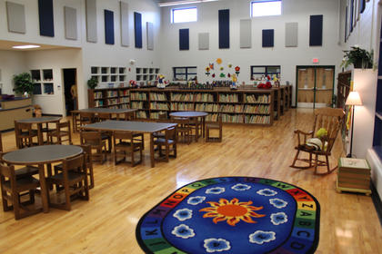 The new Foster Heights Media Center, where the former gymnasium used to be, still uses the old gym's floors. The Media Center also opened to students Oct. 17, the Monday after fall break.