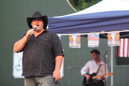 Vince Hall, Bardstown, sings an original song Monday night.