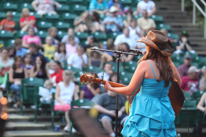 Madison Salsman, Bardstown, performs as the crowd at the J. Dan Talbott Amphitheatre watches.