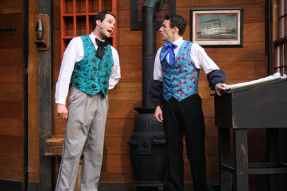 Mr. Igoe (Billy Bass) chastises Stephen Foster (Bronson Norris Murphy) for writing songs while he's working.