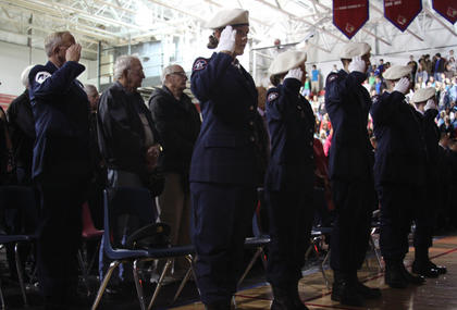The Nelson County High School ROTC Remembrance Team salutes during the school's annual Veterans Day ceremony Friday. Veterans were invited to attend the ceremony, which included a color guard ceremony and music from the Nelson County High School band.