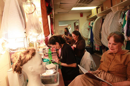 "Lee Evans, who portrays Aunt Em in the 2011 production of ""The Wizard of Oz,"" reviews her lines before a dress rehearsal the night before the Junly 7 opening night."