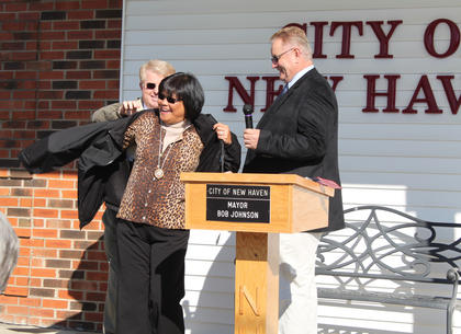 Former New Haven Mayor Tessie Cecil receives a commemorative jacket from state Rep. David Floyd and state Sen. Jimmy Higdon at a Veterans Day ceremony at New Haven City Hall the morning of Nov. 11, 2011. Cecil has helped organize the event for many years.