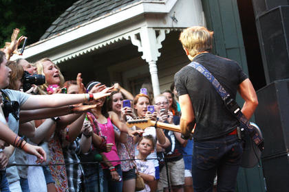Hunter Hayes, a Nashville recording artist, revs up the crowd during his concert Monday night at the J. Dan Talbott Amphitheatre.
