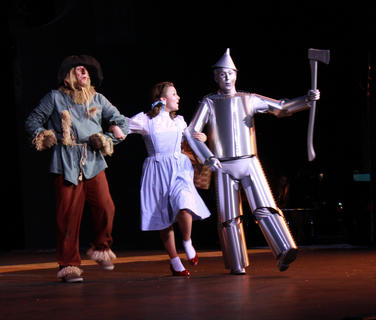 "Trevor Leaderbrand plays the Scarecrow, Trish Epperson plays Dorothy Gale, and Calvin Malone plays the Tin Man in the 2011 production of ""The Wizard of Oz"" at the J. Dan Talbott Amphitheatre. The show plays 8:30 p.m. Thursdays and Saturdays through Aug. 6."