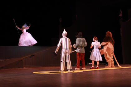 The good witch Glinda (Lucy Lemoyne) comes to the rescue after poppies have put Dorothy and her friends to sleep.