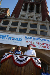 "State Sen. Jimmy Higdon discusses what he thinks makes Bardstown the ""Most Beautiful"" small town in America to Rand McNally judges, Nikki and Dusty Green, during a welcoming ceremony last Friday in front of the old courthouse."