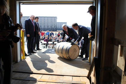 Kentucky Governor Steve Beshear and Heaven Hill President Max Shapira roll the first barrel of bourbon into Rickhouse J.