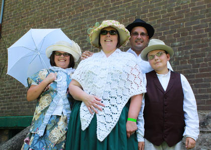 Visitors to the Wickland 19th-Century Barbecue July 9 were encouraged to dress in period costume. Posing for the photo are, from left, Bailey Bertrand, 13, Ronda Bertrand, Mike Bertrand and Thomas Bertrand, 11, of Bardstown.